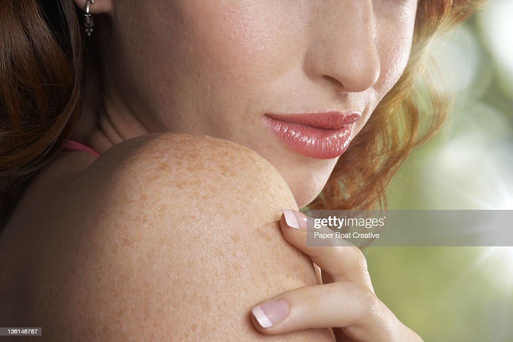 close up of a red haired woman with freckles : Stock Photo