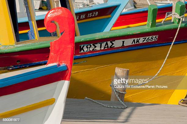 Close up of a row of colorful fishing boats in harbor, Corfu, Greece
