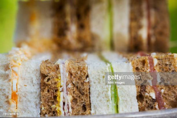 Close up of a selection of sandwiches, traditional afternoon tea fare.