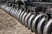 Close Up Of A Series Of Rollers On An Air Seeder