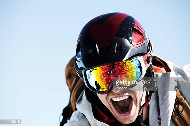Close up of a skier with helmet screaming