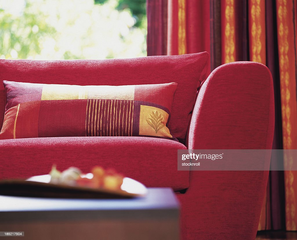 Close up of a sofa In Window with cushions : Stock Photo