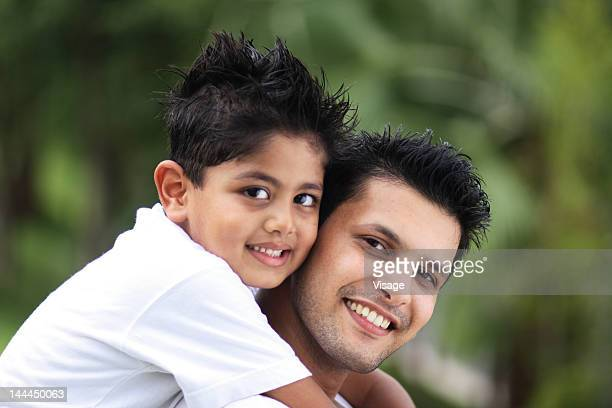 Close up of a son holding his father