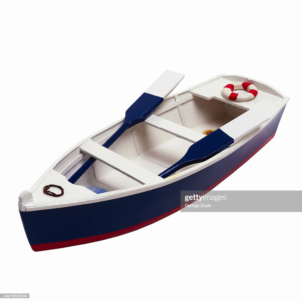 Close up of a toy boat and oars : Stock Photo