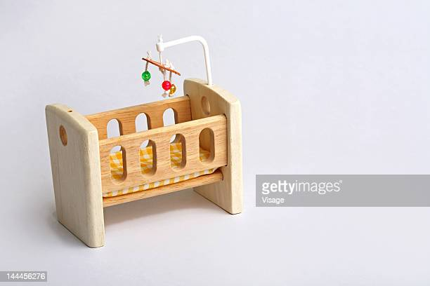 Close up of a toy cradle