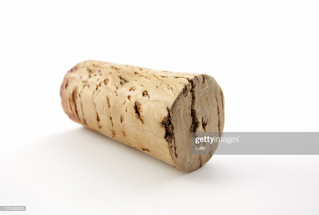 Close up of a used wine cork on white background
