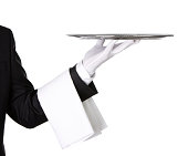 Close up of a waiter's arm holding silver tray isolated on white background