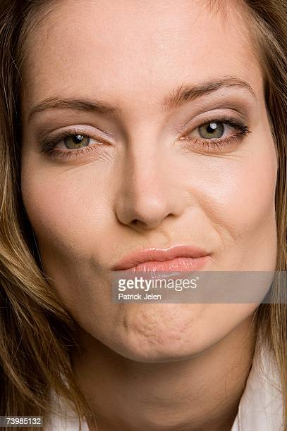 Close up of a woman looking uncertain