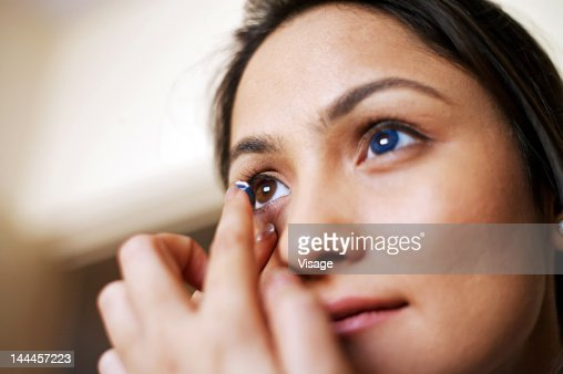 Close up of a woman wearing contact lenses : Stock Photo