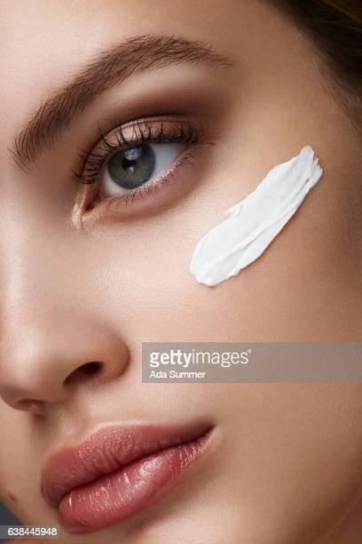 close up of a woman with cream on her face