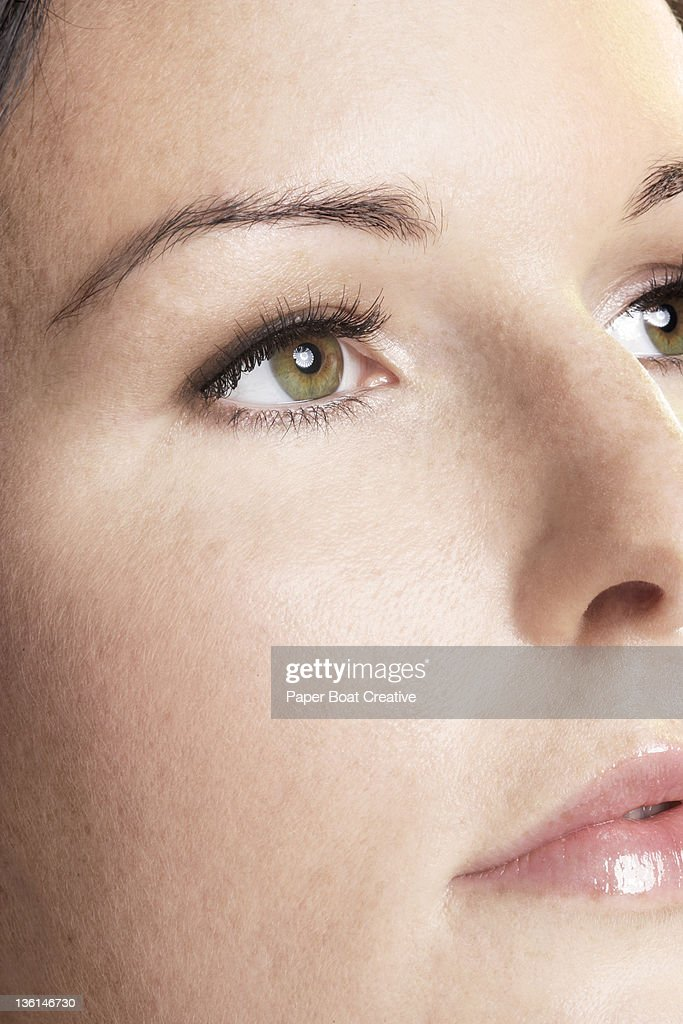 close up of a womans eye showing pupil and iris : Stock Photo