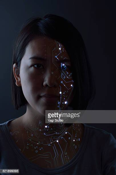 Close up of a woman's eye with futuristic graphics