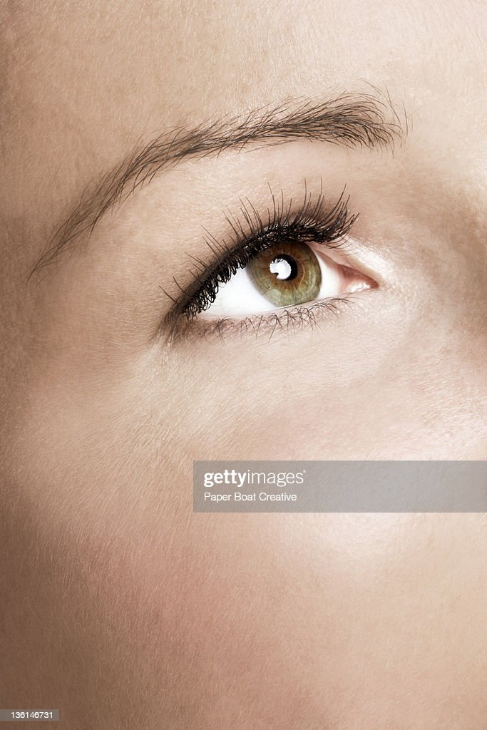 close up of a woman's eyes with false eyelashes