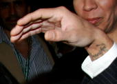 A close up of actor/singer Marc Anthony's wrist revealing a 'Jennifer' tattoo is seen as he arrives at the TIFF special presentation screening of 'El...