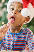 Close up of African American boy licking candy cane