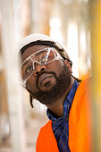 Close up of African american construction worker. Low angle view