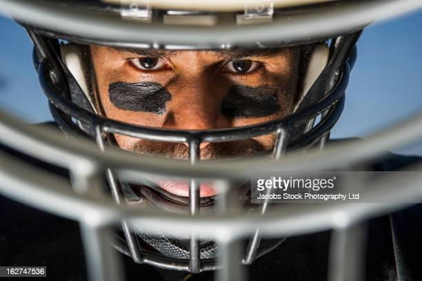 Close up of African American football player