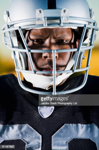 Close up of African football player in helmet