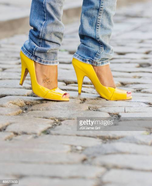Close up of African woman wearing yellow high heels