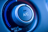 Close up of air conditioning button in a car