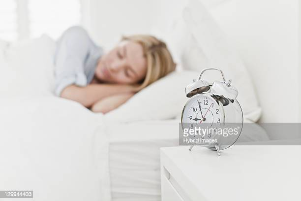 Close up of alarm clock on bedside table