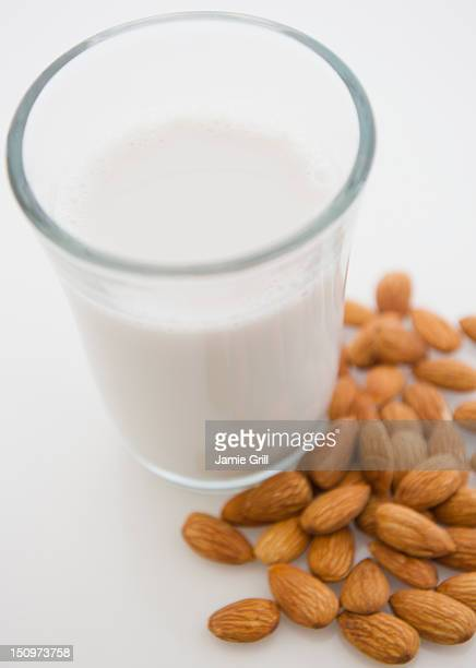 Close up of almond milk and almonds