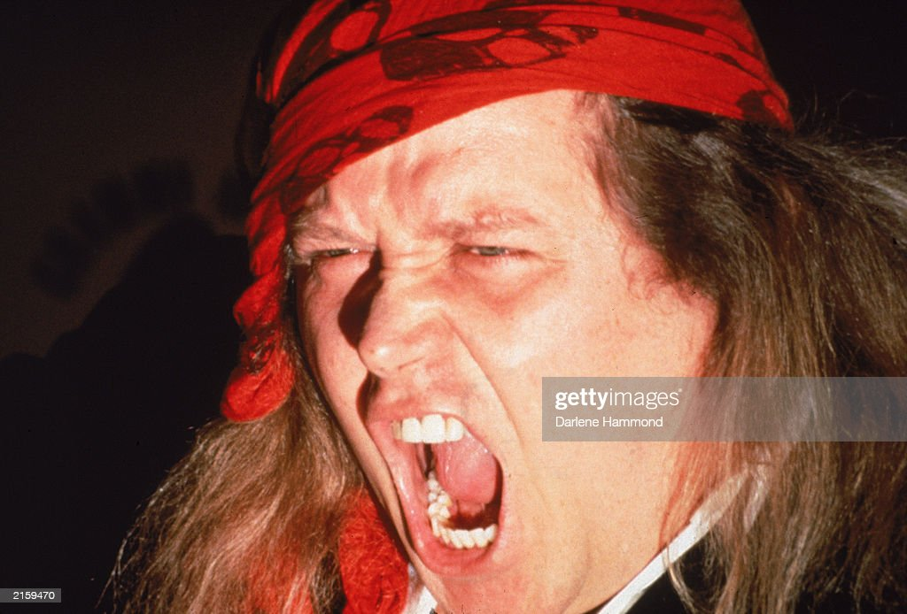 A close up of American comedian Sam Kinison (1953 - 1992) screaming at the Grammy Awards at the Shrine Auditorium, Los Angeles, California, February 21, 1990.