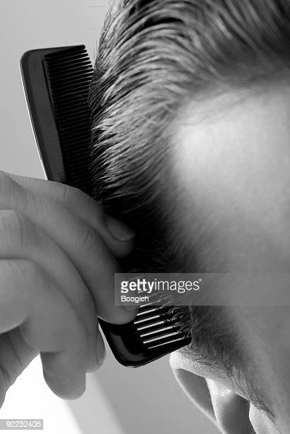 Close Up of American Man Combing Hair
