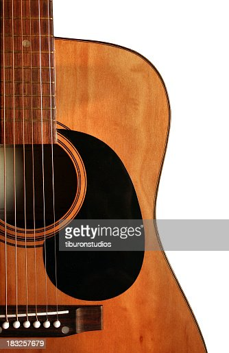A close up of an acoustic guitar