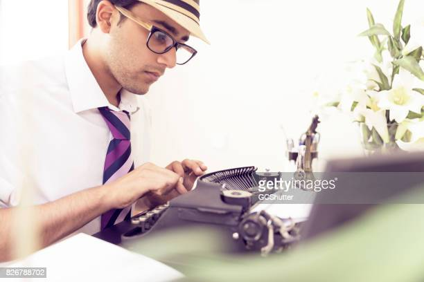 Close up of an author at work