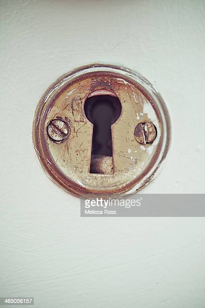 Close up of an old keyhole on a door.