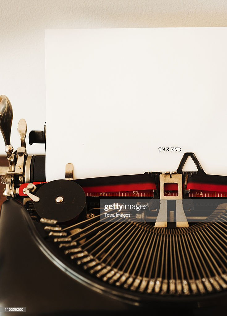 Close up of antique typewriter with ''the end'' print on page