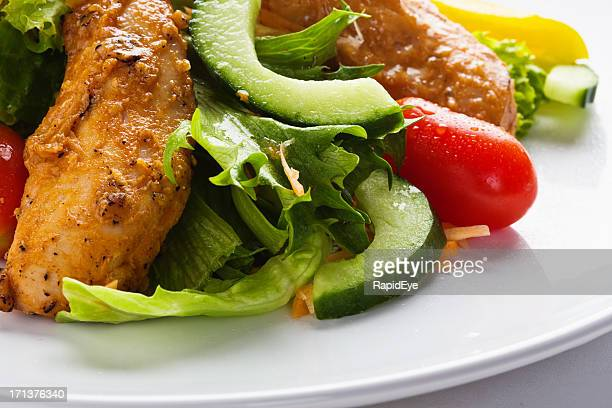 Close up of appetizing Tandoori chicken and salad