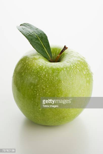 Close up of apple with water droplets