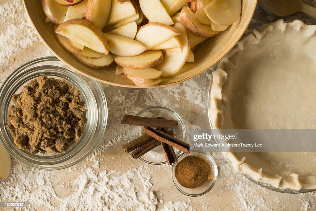 Close up of apples, spices and empty pie shell