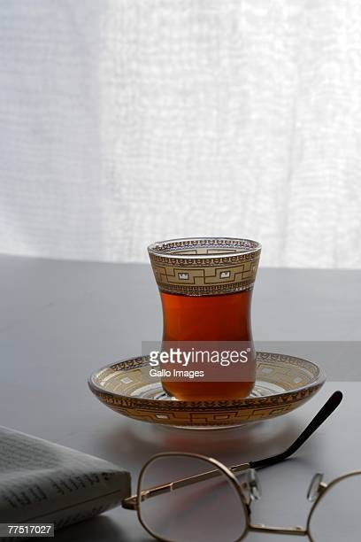 Close Up of  Arabic Coffee, Reading Glasses and Newspaper. Dubai, United Arab Emirates
