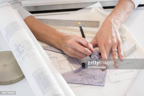 Close up of architect's hands using a triangle