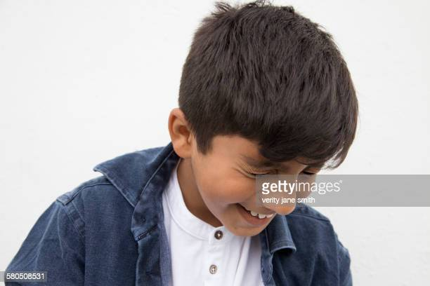 Close up of Asian boy laughing