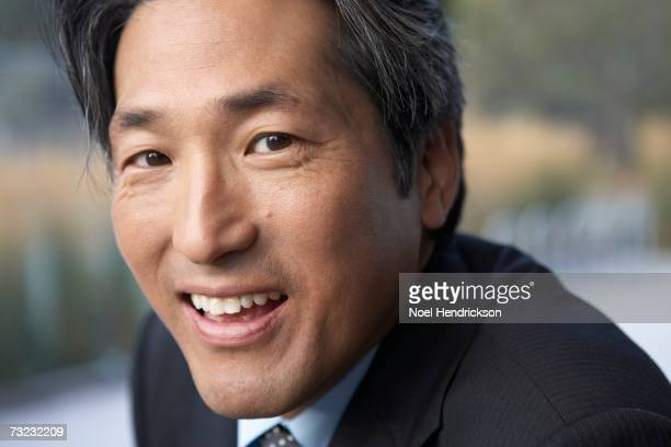Close up of Asian businessman smiling