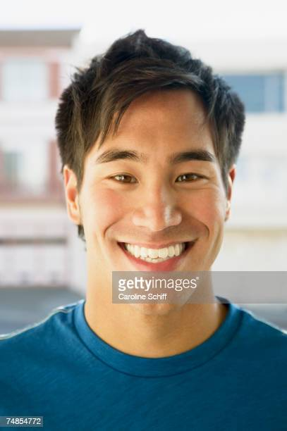 Close up of Asian man smiling