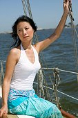 Close up of Asian woman sitting on sailboat
