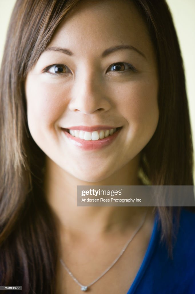 Close up of Asian woman smiling : Stock Photo
