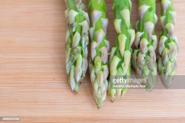 Close up of asparagus or 'Asparagus officinalis' in cutting board Raw food ingredient The vegetable is popular in Canadian cuisine
