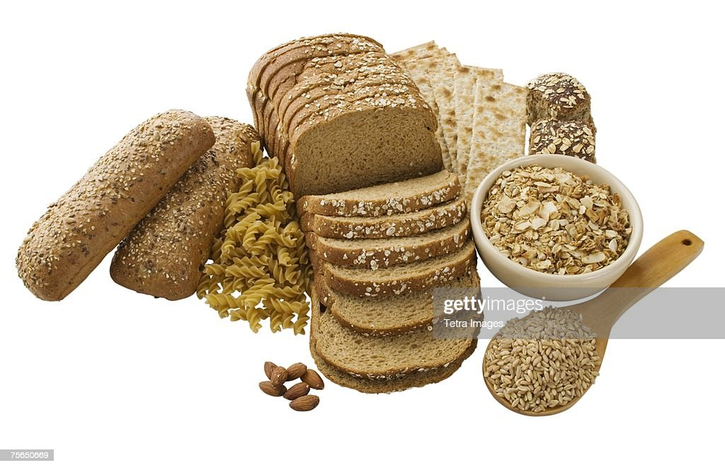 Close up of assorted grains and bread : Stock Photo