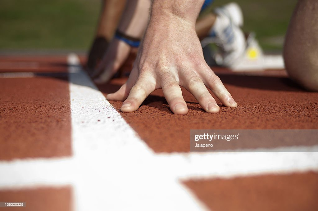 Close up of athlete's hand on track : Stock Photo