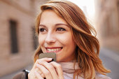 Close up of attractive young woman with smartphone
