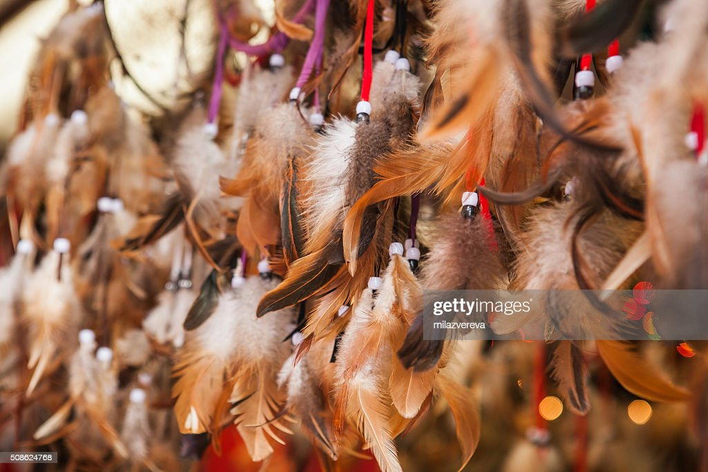 Close up of authentic dreamcatchers with feathers and beads : Stock Photo