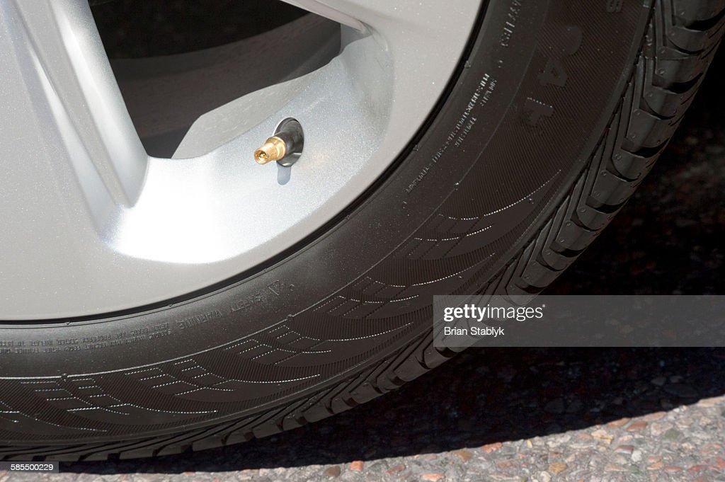 Close up of automobile tire air valve