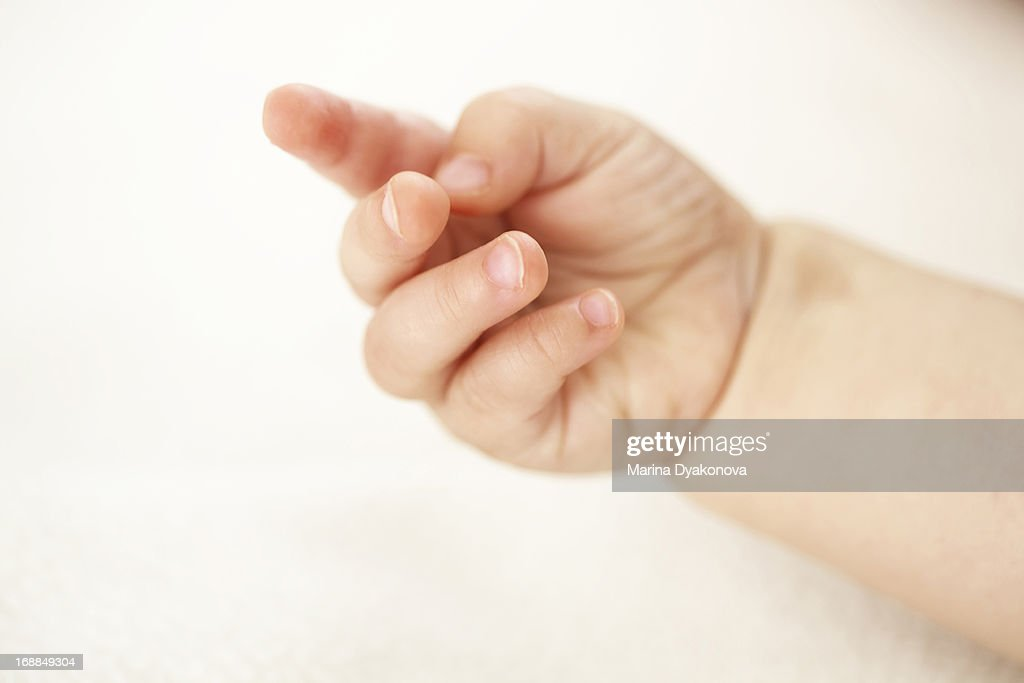 Close up of baby girls fingers : Stock Photo