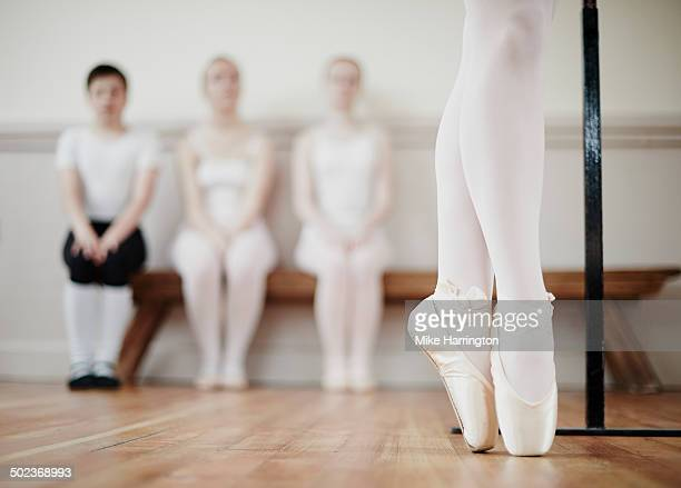Close up of ballet dancer performing point work